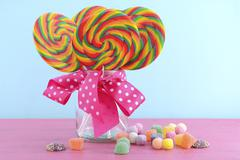 Trick or treat lollipops in glass jar. - stock photo