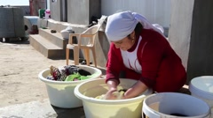 Iraq, February 2016: Iraqi woman washing clothes and sheets in a wash bucket Stock Footage