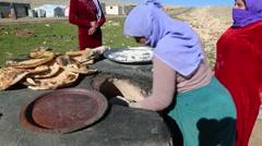 Iraq, February 2016: Iraqi women baking flat bread Stock Footage