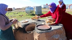 Iraq, February 2016: Iraqi women pulling out and arranging a stack of Taboon Stock Footage
