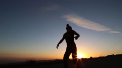 Man, jumping, catching football and running - stock footage