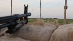 The Kurdish frontline in Iraq with machine gun in the foreground Stock Footage