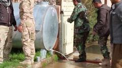 Iraq, February 2016: Men washing their hands on the Kurdish frontline Stock Footage