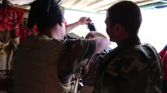 Iraq, February 2016: Kurdish soldier reloading a machine gun on the frontline Stock Footage