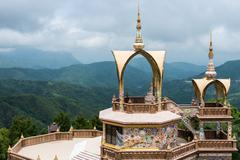 Golden sanctuary with  white Buddha statue Stock Photos