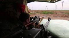 Iraq, February 2016: Kurdish sniper scanning with his rifle next to a machine gu - stock footage