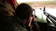 Iraq, February 2016: Kurdish, Pesh Merga sniper looking for targets Stock Footage