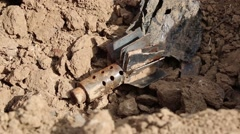 Close up of a spent shell on the Kurdish frontline Stock Footage