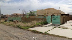 Left pan of abandoned houses in a Iraqi town Stock Footage