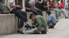 Two boys polishing shoes on the street, Guatemala Stock Footage