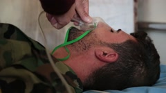 Unconscious Kurdish soldier being given oxygen Stock Footage