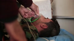 Iraq, February 2016: Unconscious soldier on bed being given oxygen Stock Footage