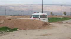 Iraqi ambulance driving away from the Kurdish frontline - stock footage