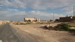 Driving through a bombed out and destroyed Iraqi town Stock Footage