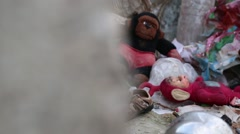 Children's sandal and a pile of toys in an abandoned town in Iraq Stock Footage