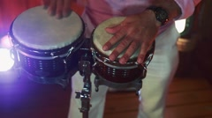 Close-up of man's hands playing congas Stock Footage
