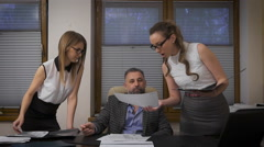 Two women assistants to apply for signature to his boss. A respectable Stock Footage