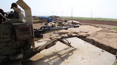 Large Kurdish machine gun being aimed at the ISIS frontline - stock footage