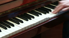 Playing piano. man playing piano Stock Footage