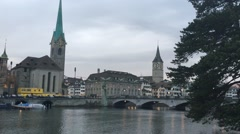 Foot traffic walking down a bridge over the Limmat river in Zurich, Switzerland Stock Footage