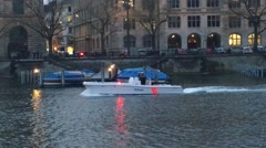 Police boat going down the Limmat river in Zurich, Switzerland Stock Footage