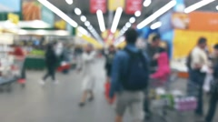 People are shopping in a supermarket, defocused blurred background Stock Footage