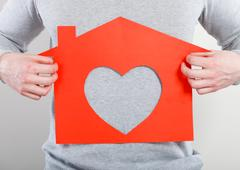 Part body man with heart house. Stock Photos
