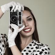 Young woman making photos with vintage film camera Stock Photos