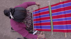 Woman weaving a shawl - stock footage