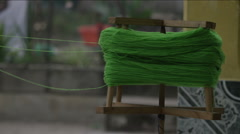 Rotating wooden reel with green wool Stock Footage