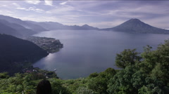 Girl standing on a hill and looking at the beautiful lake, Guatemala - stock footage