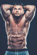 Strong Athletic Man Fitness Model Torso showing six pack abs. is Stock Photos