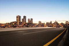 Empty asphalt road with cityscape and skyline of san francisco Stock Photos