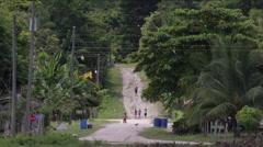Local people walking in path, Guatemala - stock footage