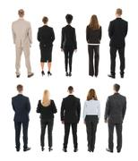 Rear View Of Businesspeople Standing In Row Against White Background Stock Photos