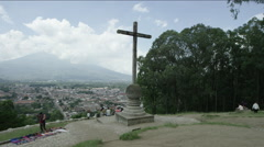 Group of tourist walking near the crucifix at Guatemala Stock Footage