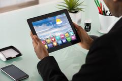 Close-up Of Businesswoman Looking At Applications On Digital Tablet Screen Stock Photos