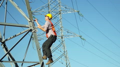 Worker Climbs Electrical High Tension Pole Stock Footage