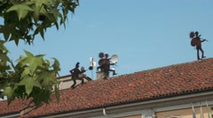 Chimney sweepers sculptures on the roof of town hall, Gravellona Lomellina, PV, - stock footage