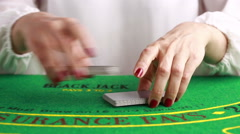 dealer handling playing cards at a poker table - stock footage