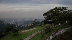 Aerial Dona Marta hills, heliport and forest Rio de Janeiro city Stock Footage