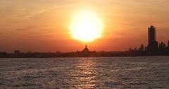 Sunset Behind Ellis Island in New York 4k Stock Video - stock footage