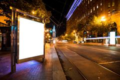 Blank billboard on road with tramway in san francisco at night Stock Photos