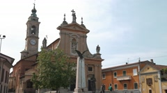 Church, houses and war memorial in Gravellona Lomellin, PV, Italy Stock Footage