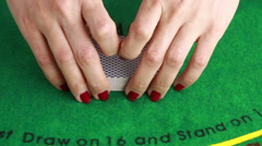Dealer handling playing cards at a poker table Stock Footage