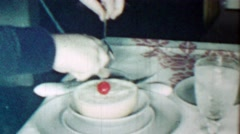 1961: Formal grapefruit cherry on top breakfast table setting. Stock Footage