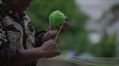 Mid section of man making a ball of wool, Guatemala - stock footage