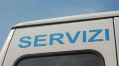 "Back of a van reading ""Servizi Sociali"" (Social Services) - stock footage"