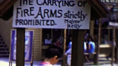 1959: Carrying of Firearms strictly prohibited sign by Mayor Kelly. - stock footage