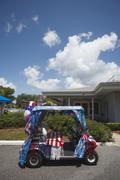 Golf cart decorated for Fourth of July Stock Photos